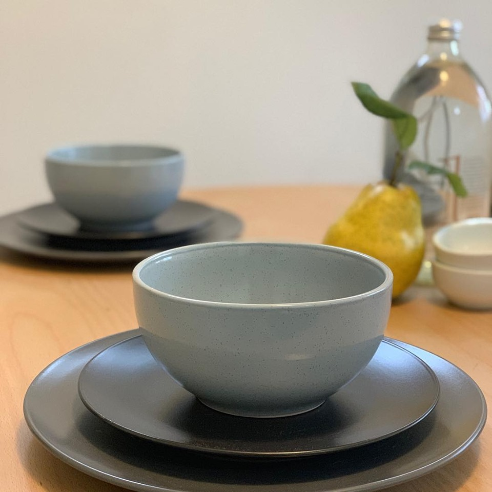 a couple of cup and saucer in a table